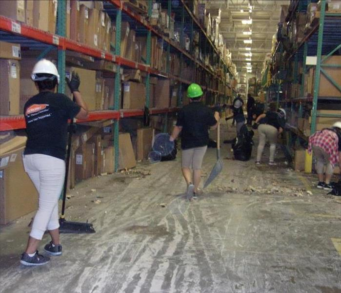 SERVPRO team members in action cleaning.